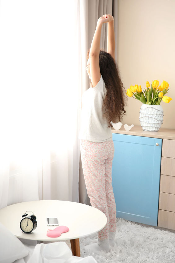 Woman stretching after waking up in the morning.