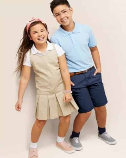 Two children in school uniforms.