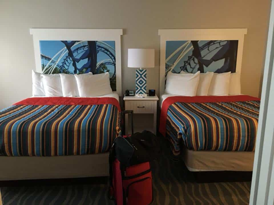 A bedroom with a bed and a chair in a room. My Stay at Hotel Breakers Cedarpoint
