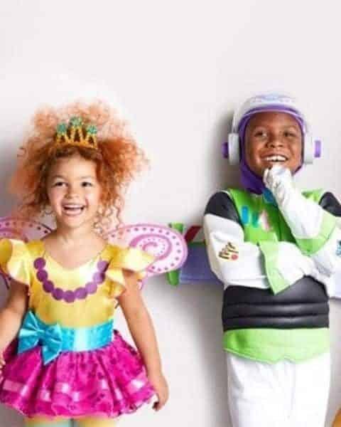two kids wearing Disney costumes