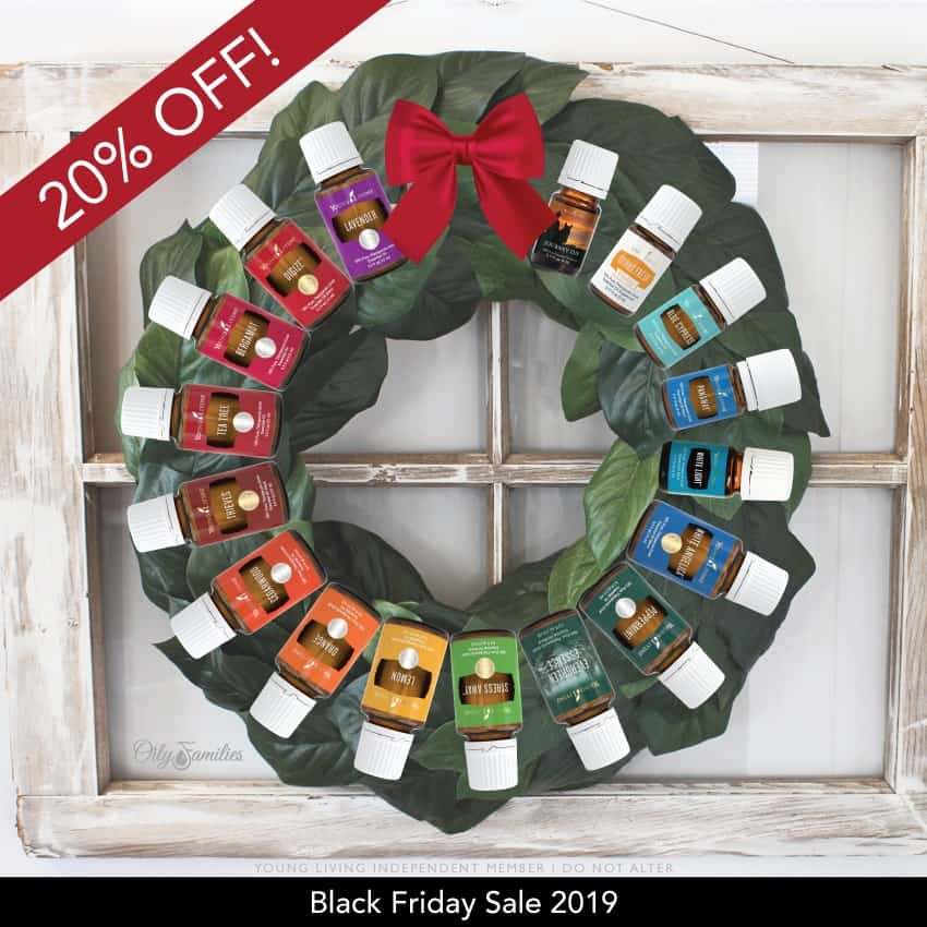 A Christmas wreath of colorful essential oils bottles from Young Living Black friday sales.