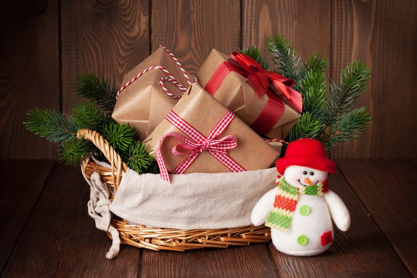 An assortment of Christmas gifts in a basket.