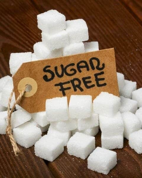 pile of sugar cubes with a sign that says sugar free