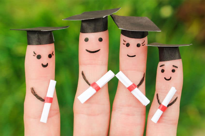Finger models dressed as graduates holding the diploma.