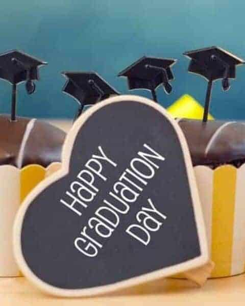 cupcakes with a small sign that says Happy Graduation Day