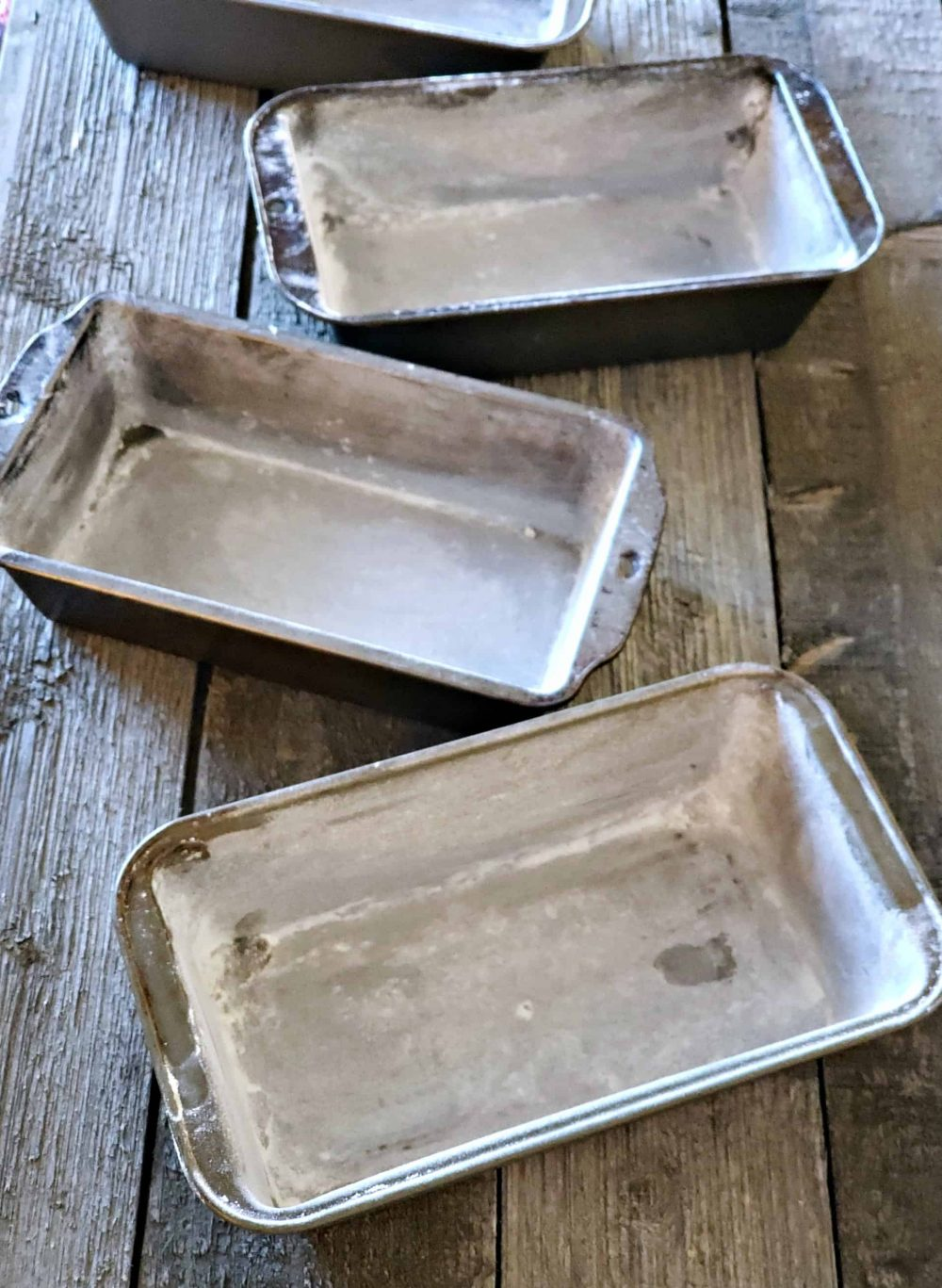 Prepare 4 bread pans for homemade bread dough.