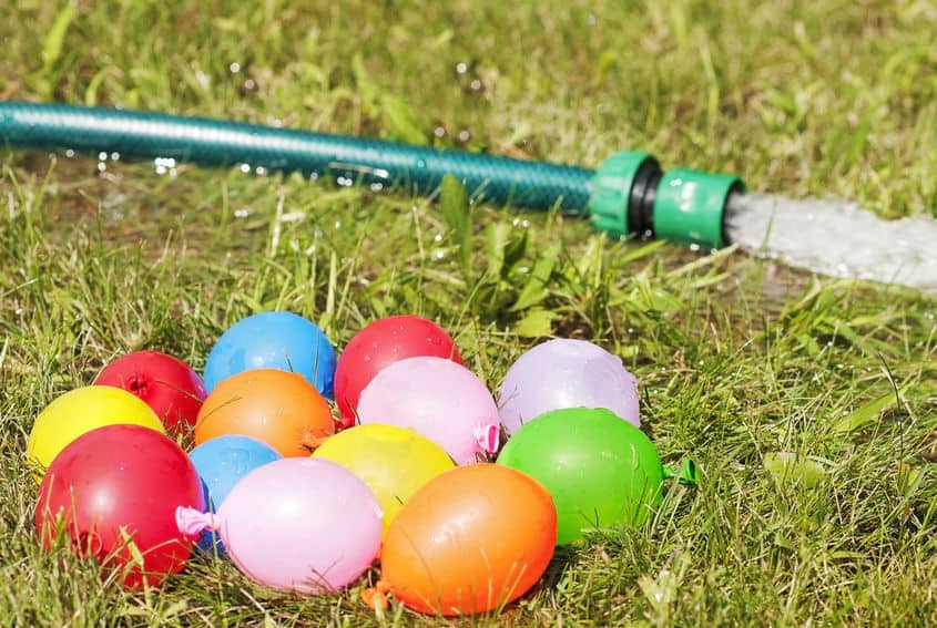 Water balloons and garden hose for summer fun.