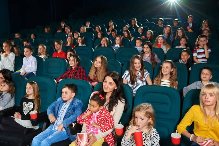Families and groups of kids gathered to watch free movies in the movie theater.