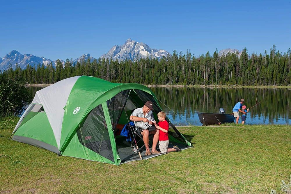 A family going camping in a Coleman tent.