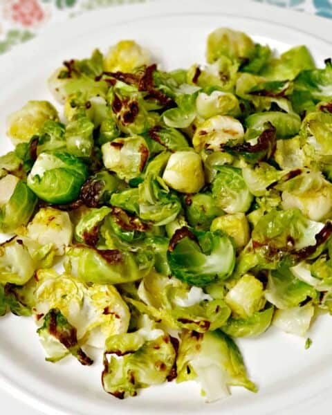 baked Brussel sprouts on while plate