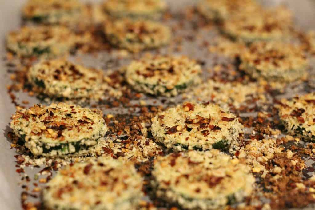 adding on chili flakes to zucchini chips