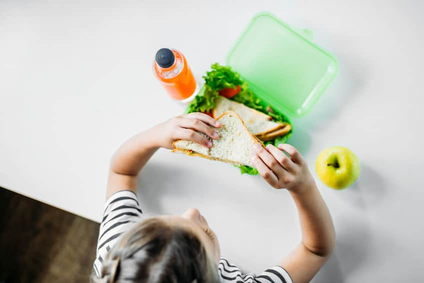 girl eating a school lunch