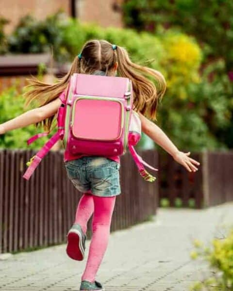 Little girl with pink backpack. | Back to school tips for saving money.