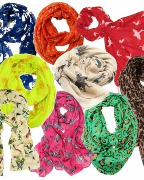a bunch of different colored animal print scarves