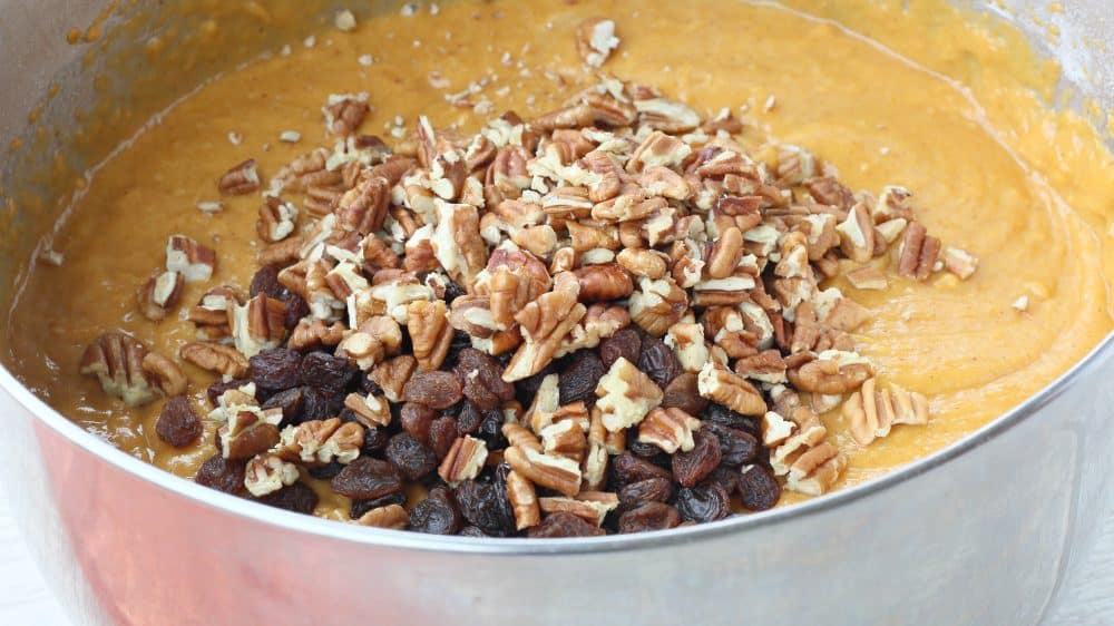 Add nuts and chocolate chips into the Easy Pumpkin Bread Recipe.