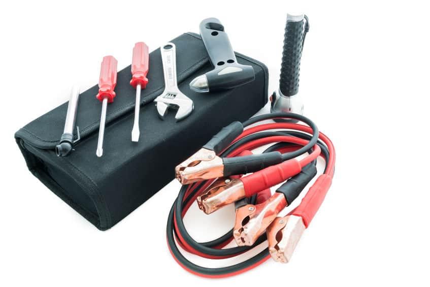 Emergency kit , car jack, jumper cables for car on white back ground