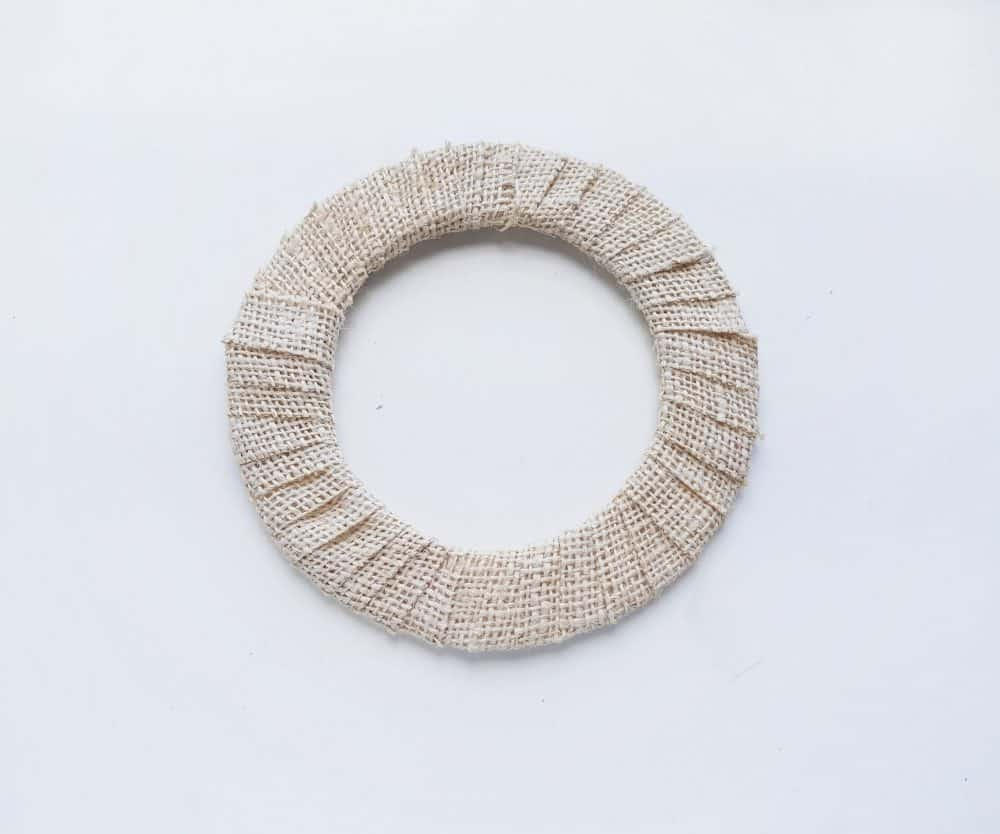 Wrap burlap around the wreath to create a Nativity Scene Wreath Craft