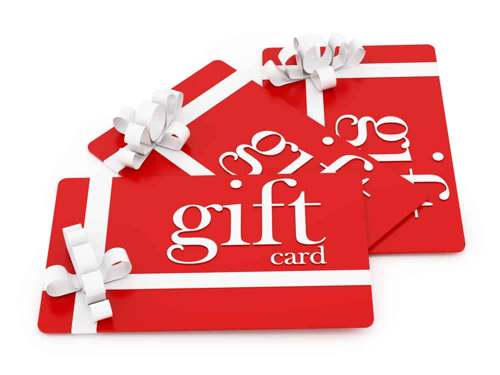 A stack of red gift cards with beautiful white ribbons.