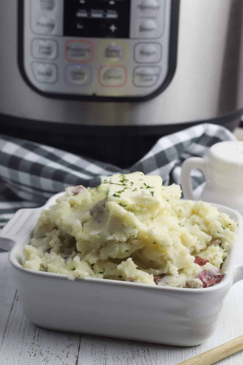 instant pot mashed potatoes red in front of an Instant Pot.