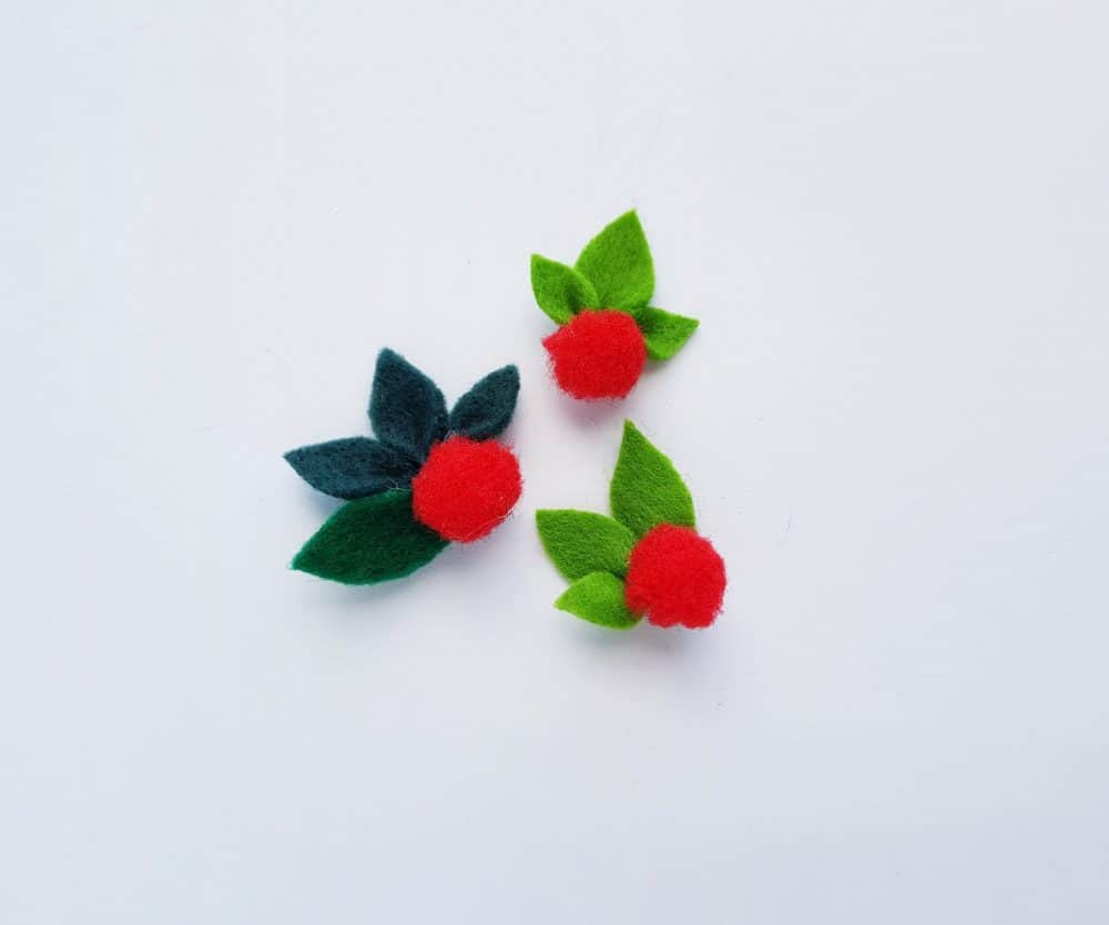 Add pompom\'s to felt leaves for DIY Nativity Christmas craft.