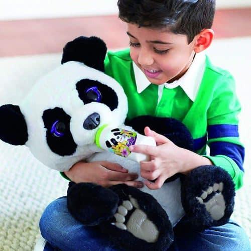 A small child is holding a panda stuffed animal
