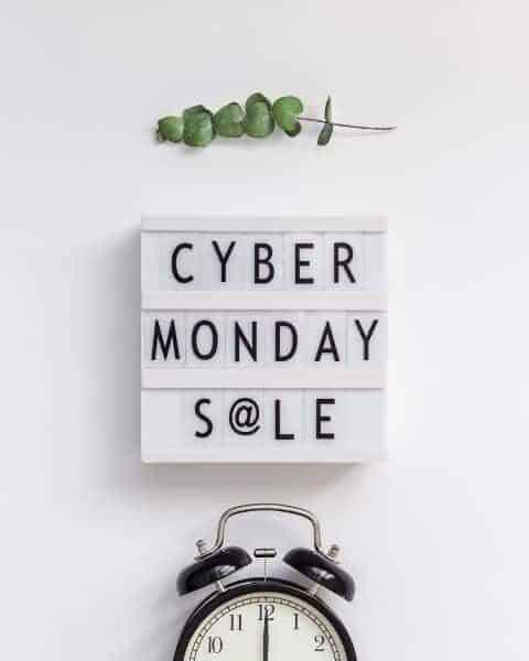 Cyber Monday Sale sign and an alarm clock