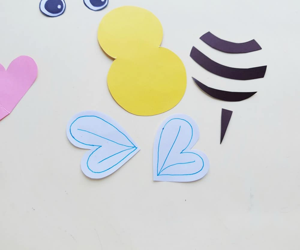 paper bee parts and drawing on bee wings
