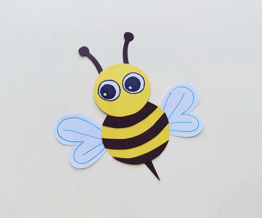 putting the eyes on the paper bee craft