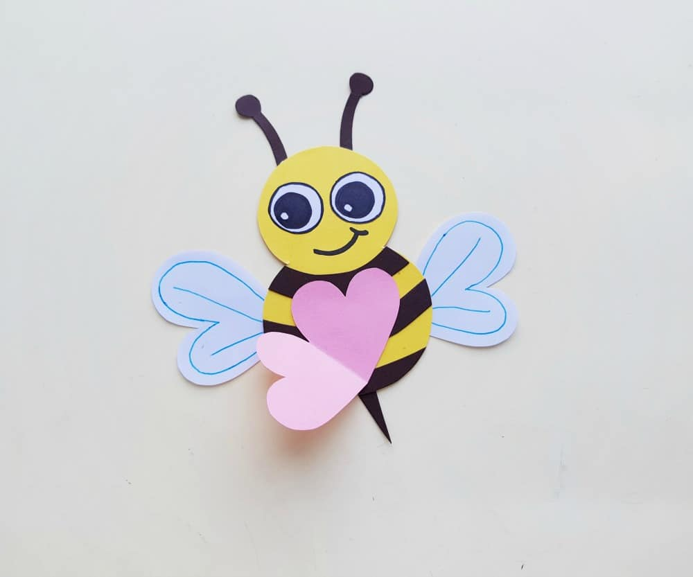 adding the heart to the paper bee craft