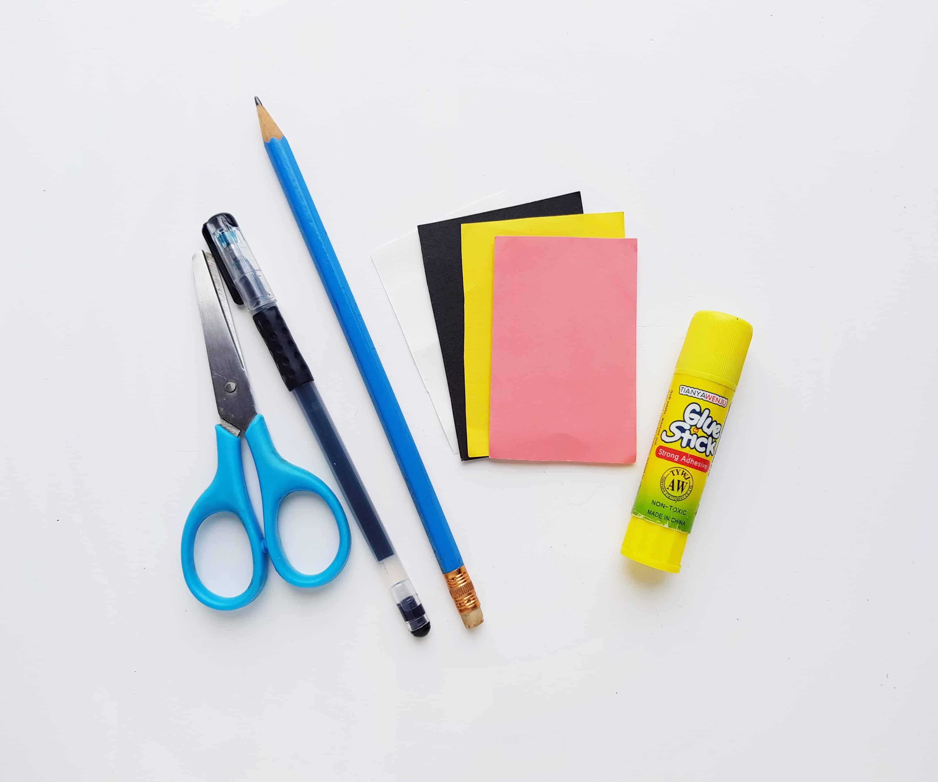 craft supplies, paper, scissors, glue stick, gel pen, pencil