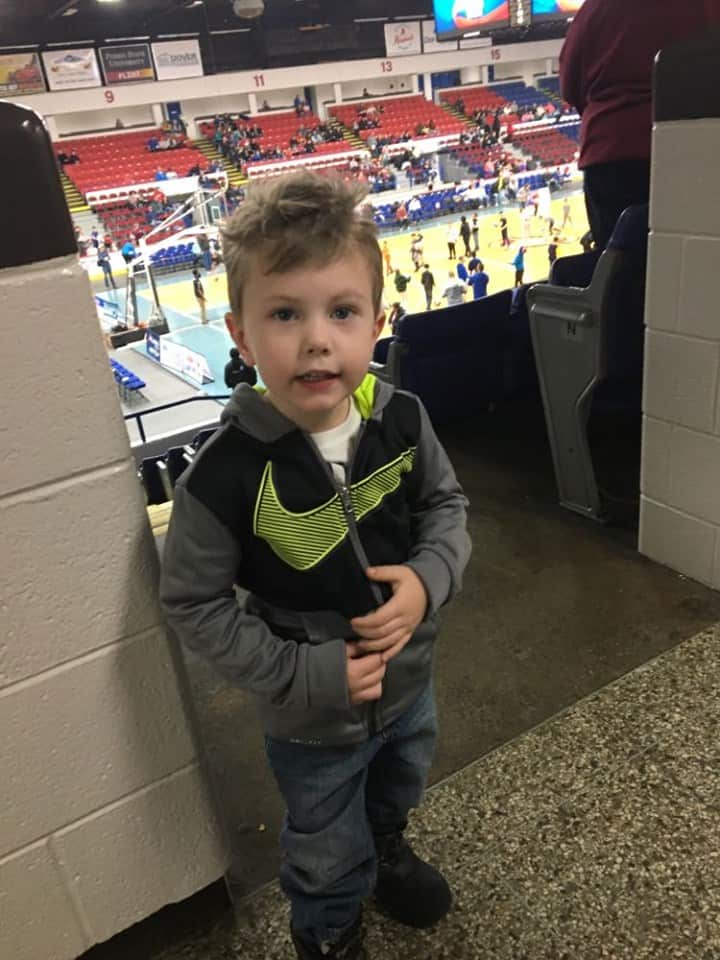 A little boy watching the Harlem Globetrotters.