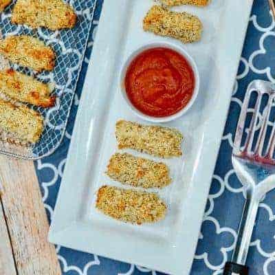 mozzarella cheese sticks on a plate with marinara sauce