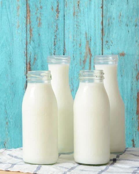 four bottles of white milk