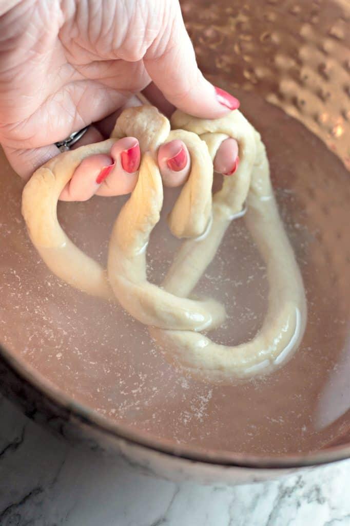 Dip pretzel dough into a baking soda mixture.