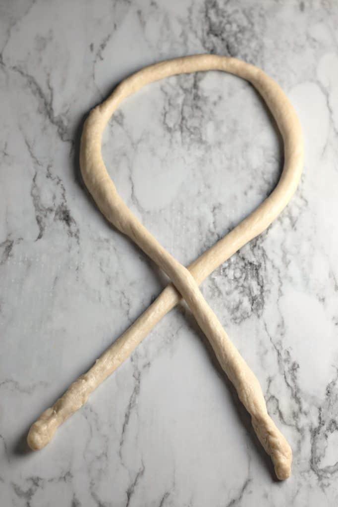 How to shape pretzel dough.