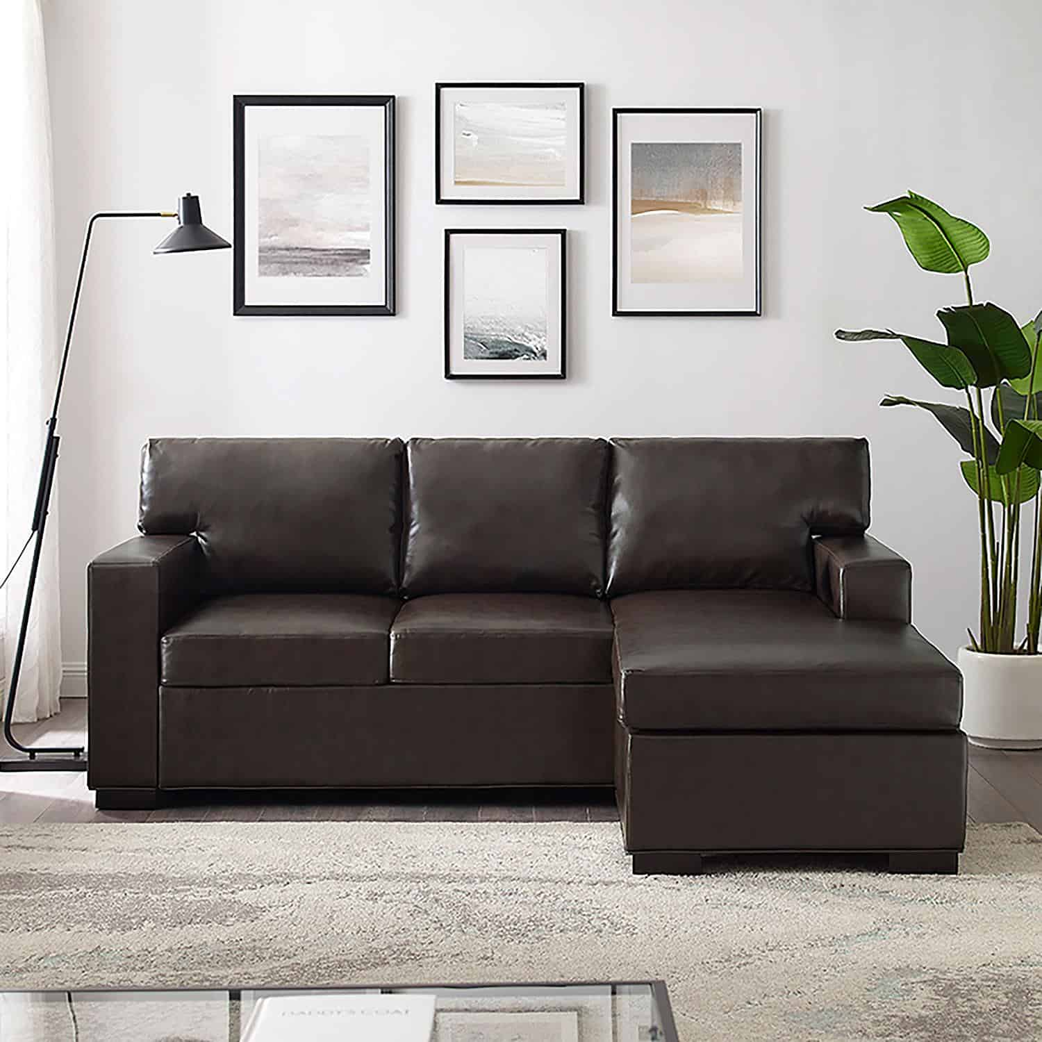 A brown leather sectional couch in a living room from Sam\'s Club.