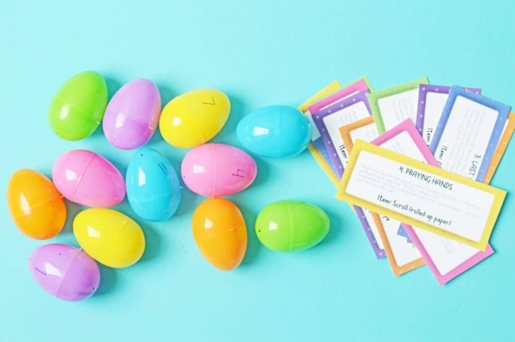 Numbered eggs next to a stack of printables for Easter.