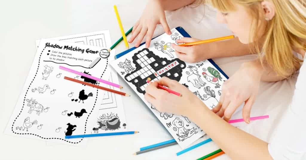 Children coloring and doing word searches with these free black and white printables.