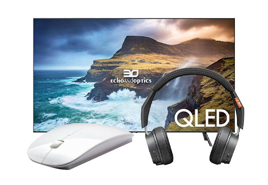 A variety of electronics and computer accessories in front of an image of a cliff side and water splashing.