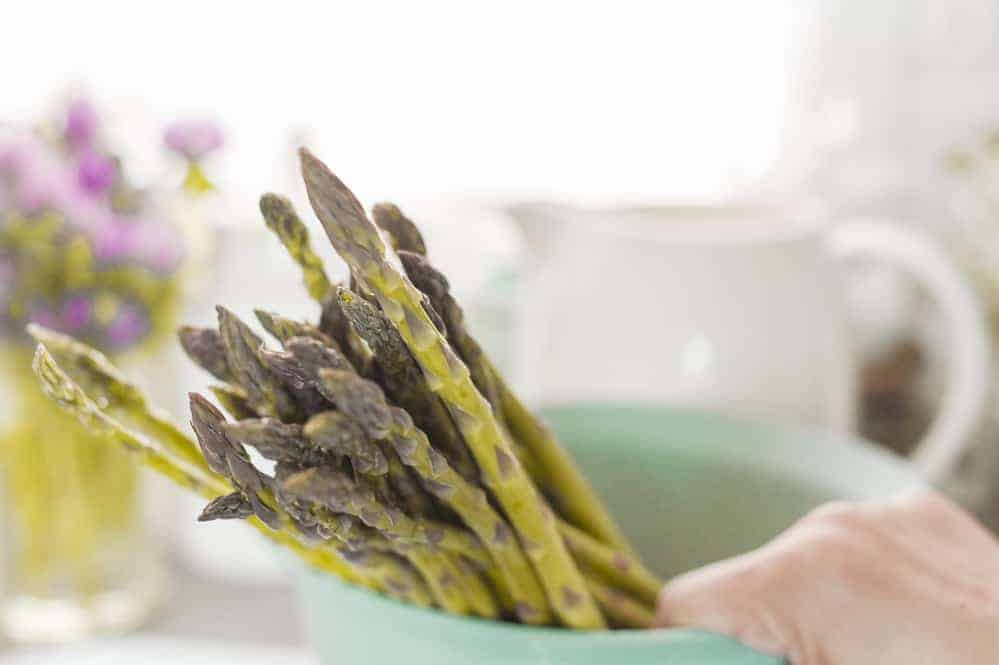 Fresh green asparagus for cooking dinner at home in the kitchen