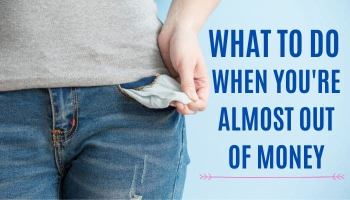 A woman showing her empty pockets. What to do when money is gone?