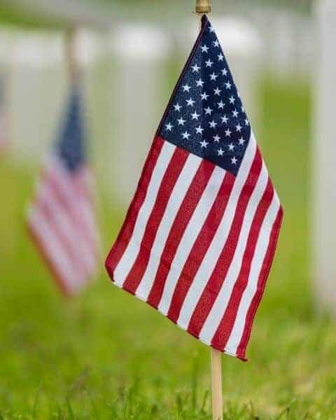 american flag sticking in the ground