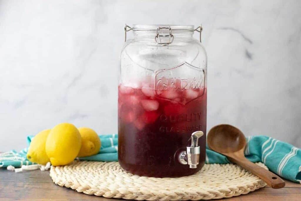 hibiscus iced tea in a large mason jar pitcher