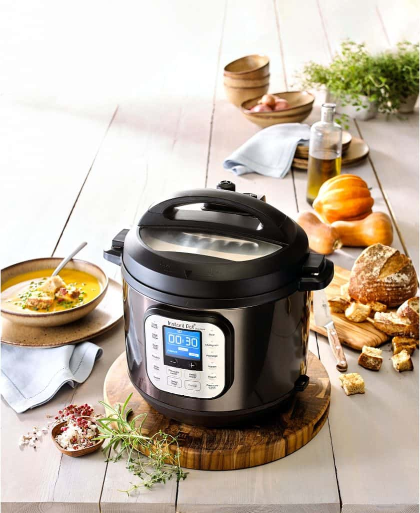 An Instant Pot and tray of food on a table