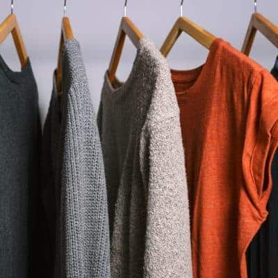Female clothes hanging on a clothing rack in a shop or home closet