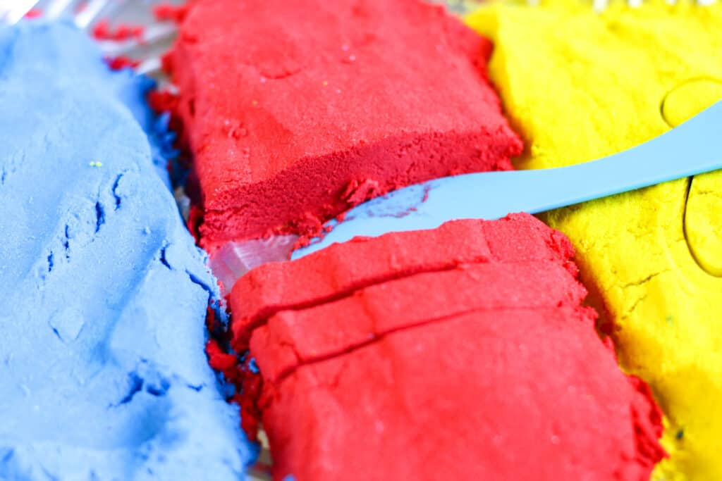 Blue, red, and yellow Homemade Kinetic Sand Recipe