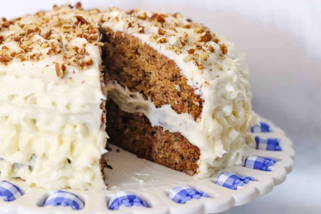 Zucchini cake with a slice of cake removed.