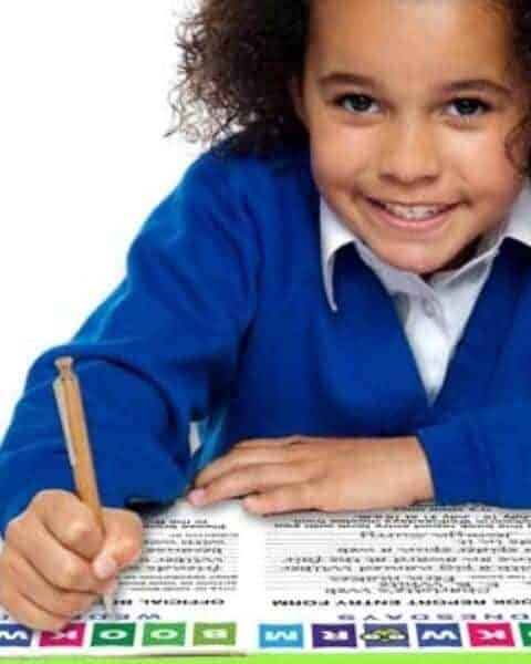 young girl writing with a pencil