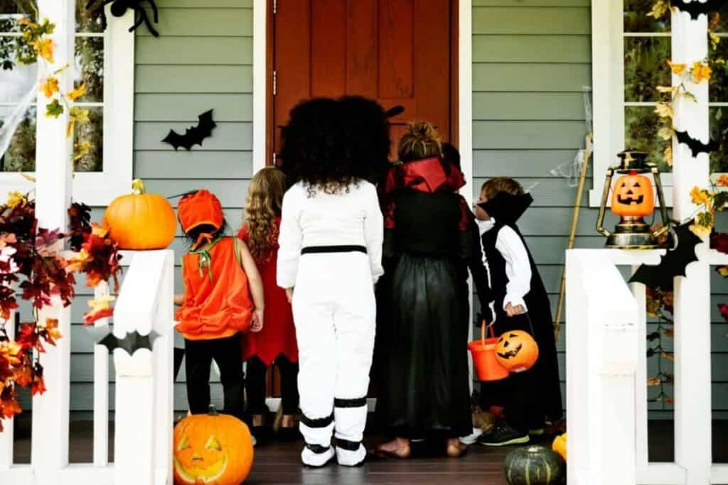 A group of children going trick-or-treating as a group.