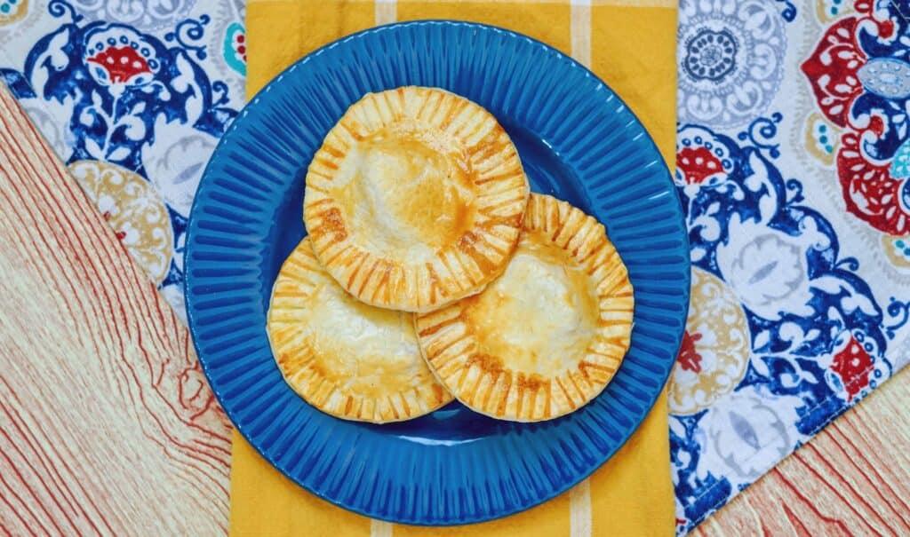 Blue plat full of Air Fryer Apple pies